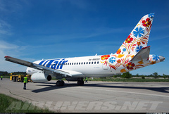 Sukhoi Superjet-100 - Moments after rolling out from the painting hangar.